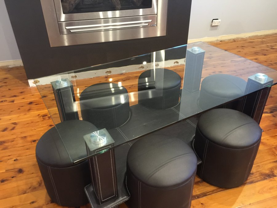 Glass/leather coffee table offer Furniture